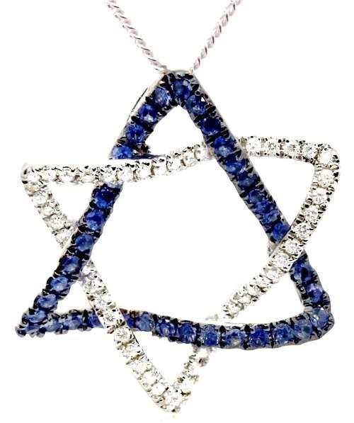 מגן דוד מזהב משובץ בעשרות יהלומים קטנים| צילום: מנחם רייס